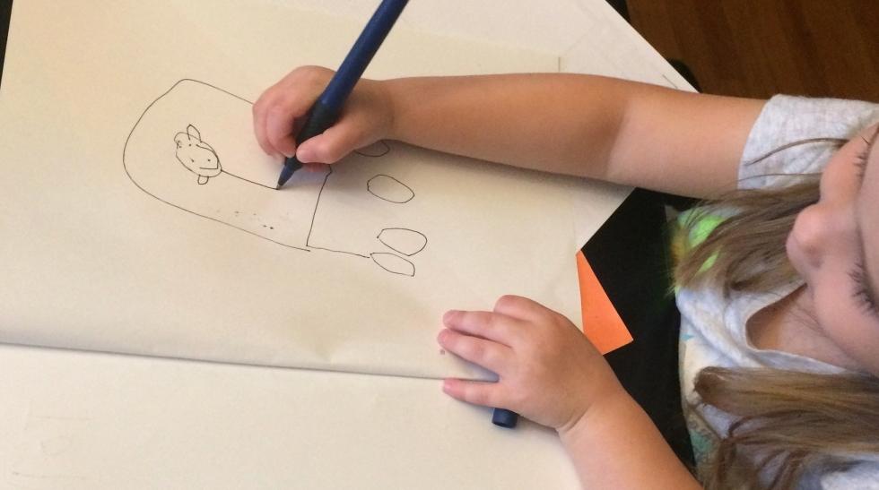 Preschool student making a picture book
