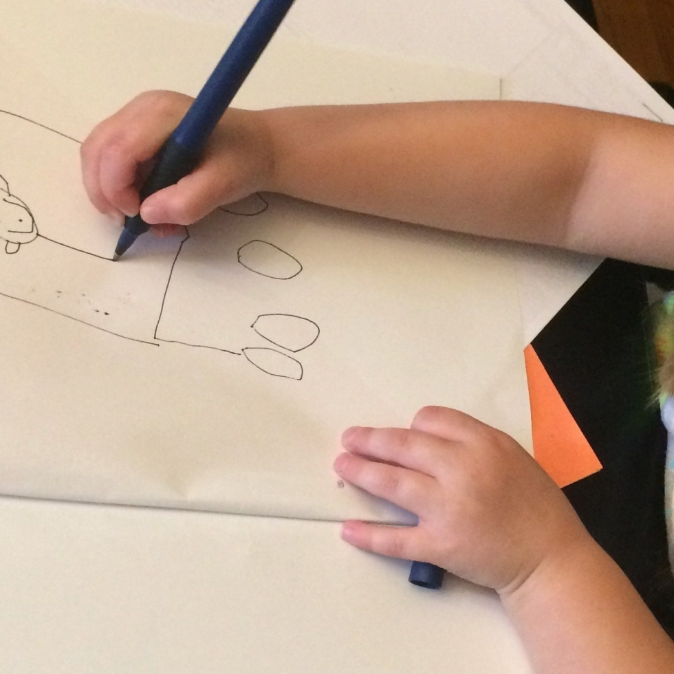 Preschool student making a picture book